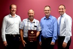 Ontario Pork Producer Bill Wymenga receives the Brian Kennedy award from the...