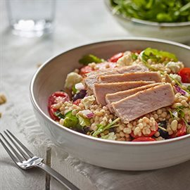Toasted pearl couscous salad with pork loin, feta and arugula